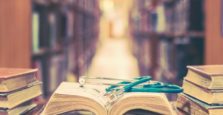 Medical library concept with stethoscope on book